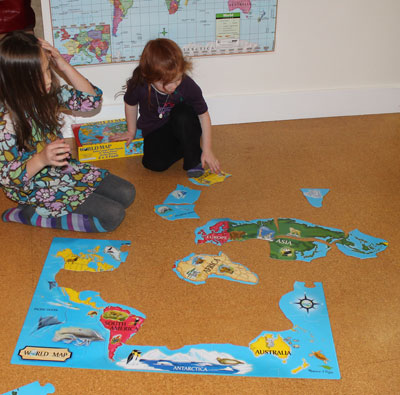 Playing with the World Map Floor Puzzle
